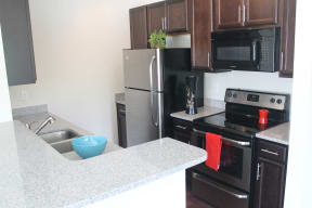model kitchen with stainless steel appliances and designer cabinetry