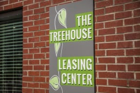 The Treehouse Leasing Center sign