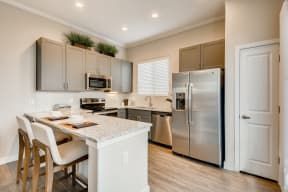 Gourmet Kitchen With Island at Avilla Reserve, Texas