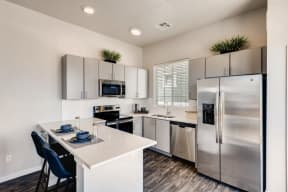 Gourmet Kitchen With Island at Avilla Buffalo Run, Colorado, 80022