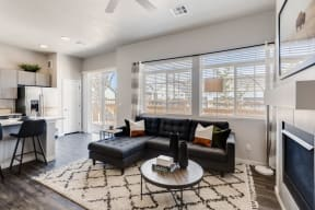 Living Room With Kitchen View at Avilla Buffalo Run, Commerce City, CO