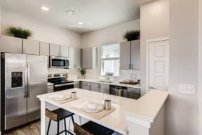 Fitted Kitchen With Island Dining at Avilla Buffalo Run, Colorado, 80022