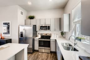 Fully Equipped Kitchen With Modern Appliances at Avilla Buffalo Run, Commerce City, Colorado