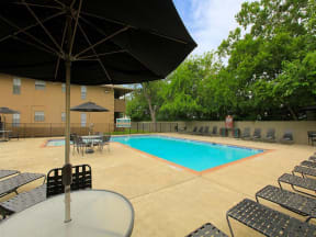 the granite at tuscany hills san antonio apartments pool deck and lounge chairs