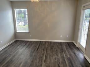 Avisa Lakes Platinum Upgrade unit spacious bedroom with wood plank floor