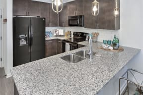 Stainless Steel Sink With Faucet In Kitchen at Residence at Tailrace Marina, North Carolina