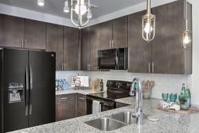 Granite Counter Tops In Kitchen at Residence at Tailrace Marina, Mount Holly, North Carolina