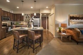 Open concept kitchen and living area   Villas at San Dorado