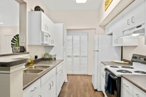 Kitchen featuring electric appliances| Lodge at Lakeline Village