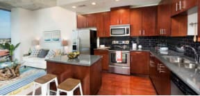 Kitchen with wood cabinets and stainless steel appliances | Element apartments