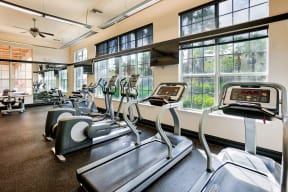 Fitness center with cardio equipment  | Estates at Heathbrook