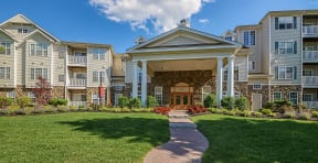 Entrance to clubhouse and leasing office  | Highlands at Faxon Woods