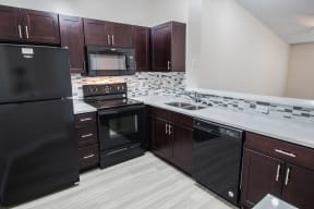 Kitchen with black appliance package | Gateway Club