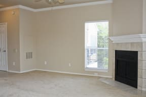 Living room with fireplace | Madison at the Arboretum