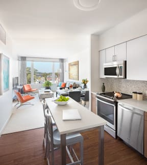 Kitchen with stainless steel appliances| The Merc at Moody and Main