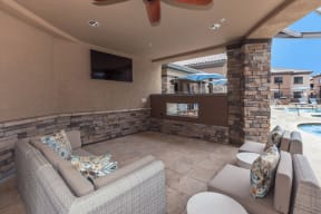 Poolside lounge with outdoor TVs | Canyons at Linda Vista Trail