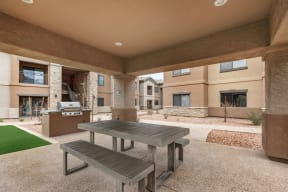 Outdoor covered patio with gas grill and picnic table | Villas at San Dorado