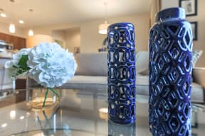 vases and flowers on coffee table