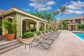 Pool deck with lounge chairs | Cypress Shores