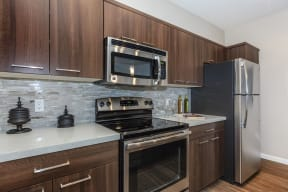 Kitchen with stainless steel appliances | Canyons at Linda Vista Trail