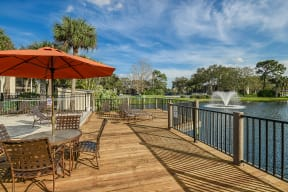 Lakeside deck with umbrellas  | Lakes at Suntree