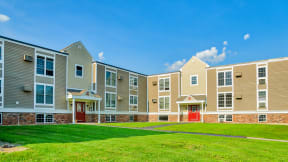 Exterior lawn and entry to Boulders apartment buildings