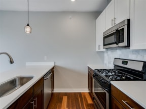 White Cabinets In Kitchens At Boutique 28 Apartments In Minneapolis, MN