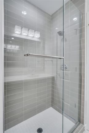 Modern Showers In Bathrooms At Boutique 28 Apartments In Minneapolis, MN