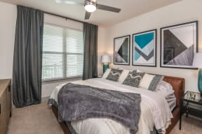 Spectacular bedroom with carpeted flooring and one enormous window in Orlando, FL apartment for rent