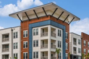 External shot of Coda Orlando apartment rentals on sunny day in Orlando, FL