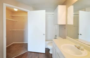 Closet Attached to Bathroom at Stoneleigh on Cartwright Apartments, J Street Property Services, Mesquite, TX