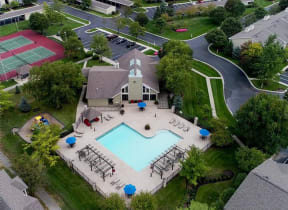 Crisp Pool and Lit Tennis Courts