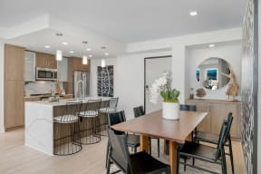 Kitchen With Breakfast Bar at The Q Variel, Woodland Hills, CA