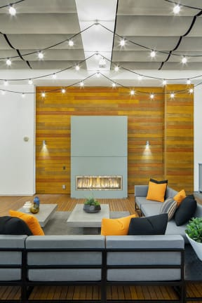 Fireplace sitting area at The Q Variel- Apartments in Woodland Hills
