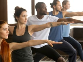 a group of young adults doing yoga