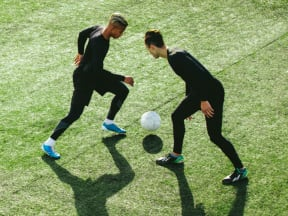 Two young men playing soccer