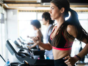 three young people running on treadmills