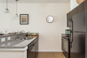 Refrigerator And Kitchen Appliances at 310 @ Nulu Apartments, Louisville