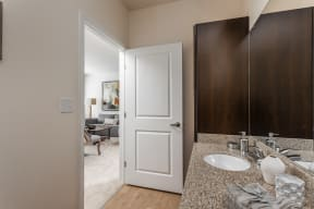 Renovated Bathrooms With Quartz Counters at 310 @ Nulu Apartments, Louisville, KY, 40202