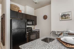 Kitchen Faucet at 310 @ Nulu Apartments, Louisville, Kentucky