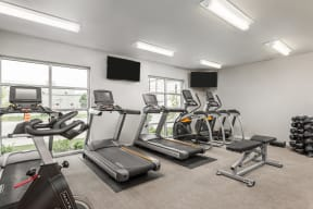 Cardio Machines In Gym at 310 @ Nulu Apartments, Louisville