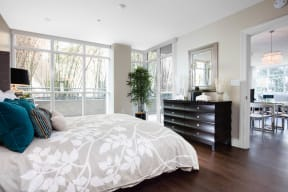 Irvine, CA Apartments - Astoria at Central Park West Bedroom With Large, Airy Windows, Hardwood Style Flooring and Stylish Decor