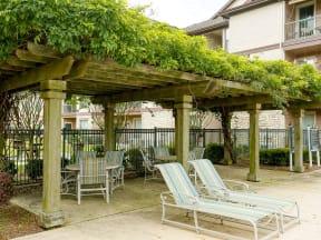 Portofino Senior Apartments poolside shaded area