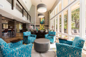 Club house interior photo showing elegant furniture with sitting area.