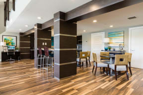 Lounge are in clubhouse with round tables, chairs and bar stools.