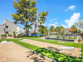 Park area with cornhole courts