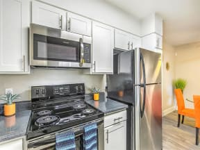 Model kitchen with stainless major kitchen appliances