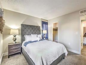 Model bedroom with queen bed