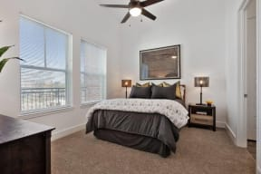 Model bedroom with large windows