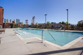 View of swimming pool and sundeck with loungers
